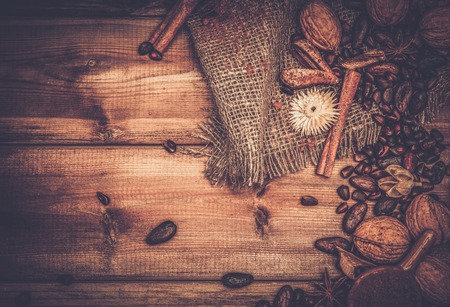 ground nuts: Coffee theme still-life with copy-space on wooden table Stock Photo