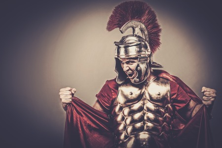 legionary: Angry legionary soldier in armour Stock Photo