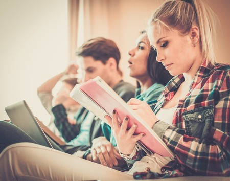Group of students preparing for exams in apartment interior Stock Photo