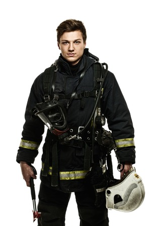 firefighter: Young firefighter with helmet and axe isolated on white Stock Photo