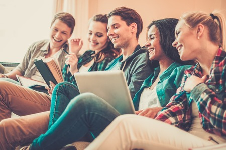 school exam: Group of students preparing for exams in apartment interior Stock Photo