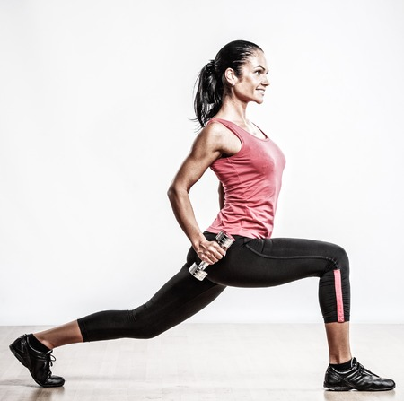 exertion: Beautiful woman doing fitness exercise with dumbbellls