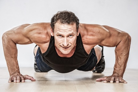 pushup: Middle-aged muscular man doing push-up Stock Photo