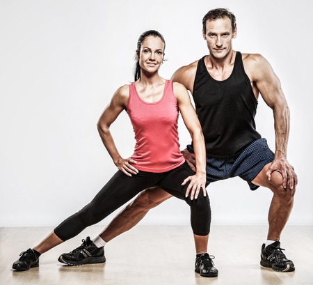 athletic woman: Athletic man and woman doing fitness exercise