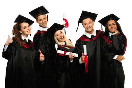 gown: Multi ethnic group of graduated young students isolated on white