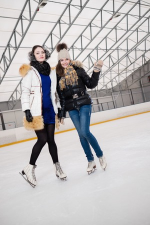 iceskating: Two girls on ice-skating rink