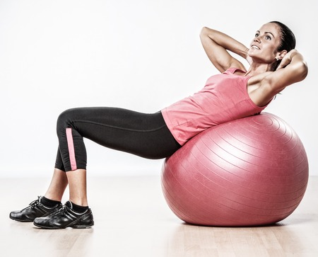 exertion: Athletic woman doing exercise on a fitness ball