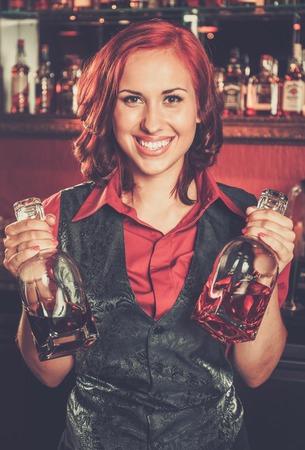 beautiful redhead: Beautiful redhead barmaid behind bar counter