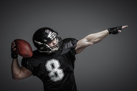 rugby player: American football player with ball