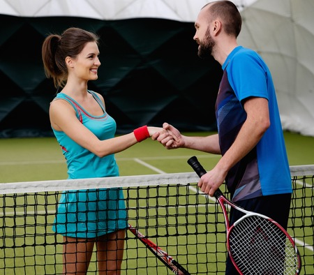 tennis net: Woman tennis player shaking hand with her coach Stock Photo