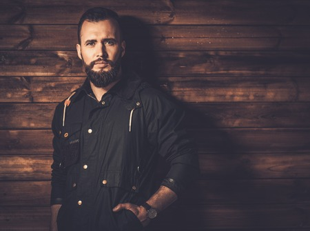 rugged: Handsome man with beard  wearing waxed canvas jacket Stock Photo