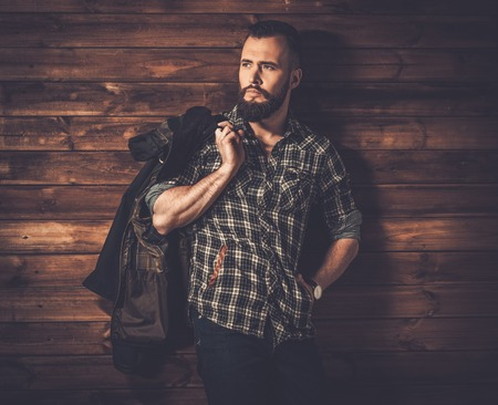 waxed: Handsome man wearing checkered  shirt and waxed canvas jacket