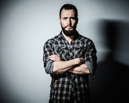 flannel: Handsome man with beard wearing checkered shirt Stock Photo