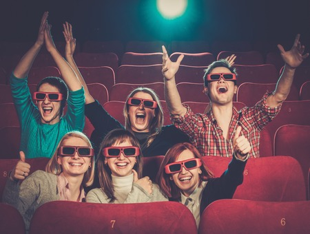 Group of people in 3D glasses watching movie in cinema Stock Photo