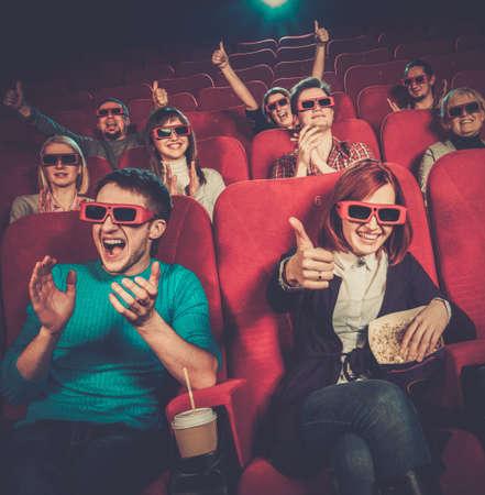 cinema people: Group of people in 3D glasses watching movie in cinema Stock Photo
