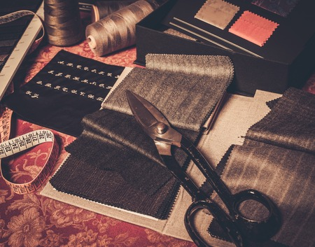 tailor shop: Cloth samples for custom made suits and jackets