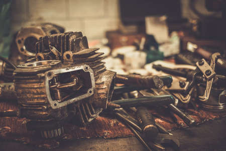 vehicle part: Part of motorcycle engine on a table in workshop