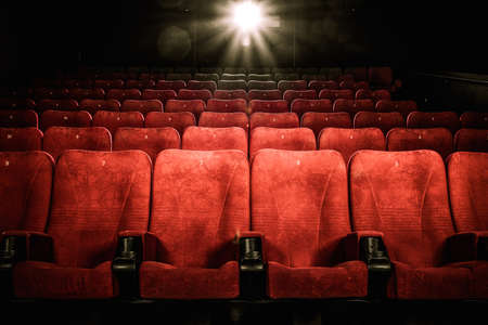theater seat: Empty comfortable red seats with numbers in cinema Stock Photo