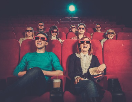 movie theater: Group of people in 3D glasses watching movie in cinema Stock Photo