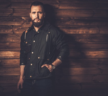 Handsome man with beard  wearing waxed canvas jacket photo