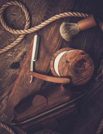 Shaving accessories on a luxury wooden background photo