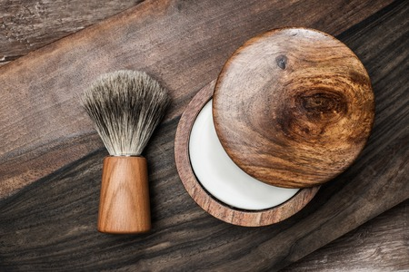 straight razor: Shaving brush and soap on a luxury wooden background