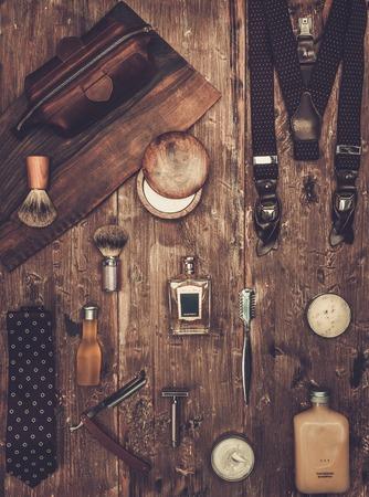 dandy: Gentlemans accessories on a on a luxury wooden board