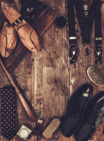 Shoe care and gentlemans accessories on a wooden table photo