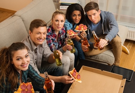 liquor girl: Group of multi-ethnic friends with pizza and bottles of drinks having party