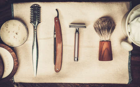 body grooming: Shaving accessories on a luxury wooden background