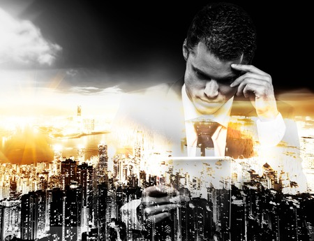 multiple exposure: Businessman with tablet pc and modern megapolis