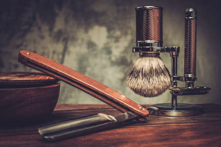 barber shave: Shaving accessories on a luxury wooden background