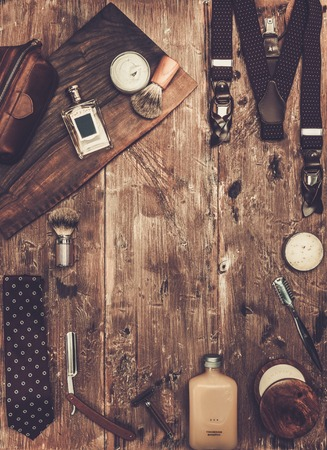 shaving blade: Gentlemans accessories on a on a luxury wooden board