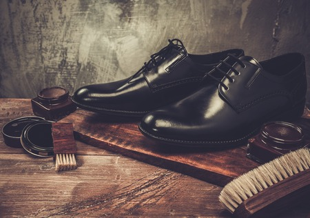 leather shoes: Shoe care accessories on a wooden table