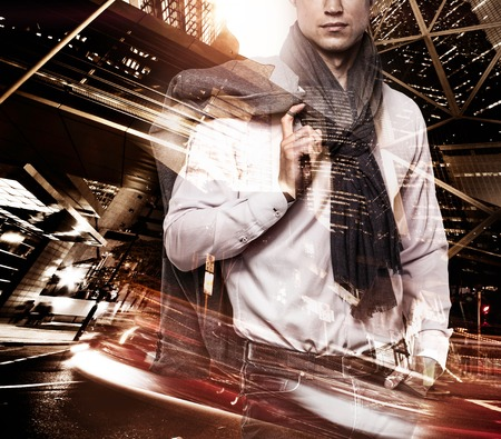 multiple exposure: Fashionable man over modern city at night double exposure Stock Photo