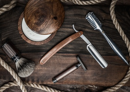 male beauty: Shaving accessories on a luxury wooden background