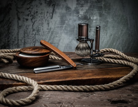 barber: Shaving accessories on a luxury wooden background