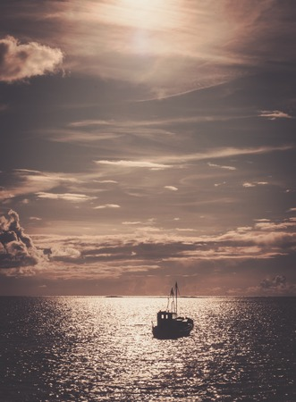 Fishermans boat in a sea photo