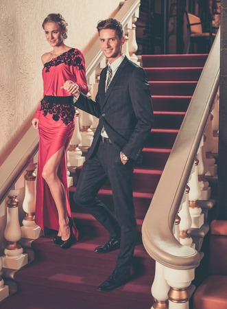 Beautiful well-dressed young couple in luxury interior Stock Photo