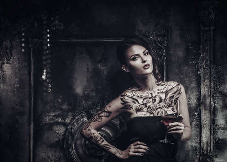 dark interior: Tattooed beautiful woman in old spooky interior