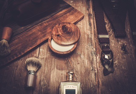 straight razor: Gentlemans accessories on a on a luxury wooden board