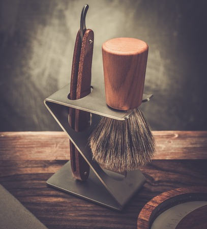 straight razor: Safety razor and shaving brush on a stand Stock Photo