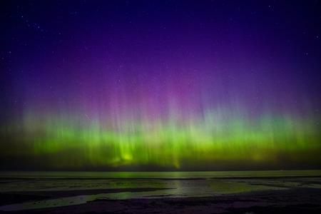 arctic zone: Beautiful Aurora Borealis over sea