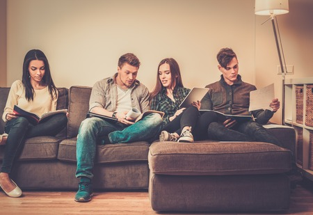 Group of students preparing for exams in apartment interior photo