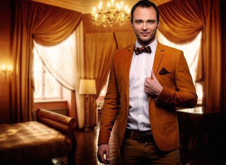 luxury apartment: Sharp dressed dandy fashionist in luxury apartment interior