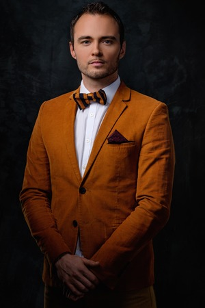 Sharp dressed fashionist wearing jacket and bow tie photo