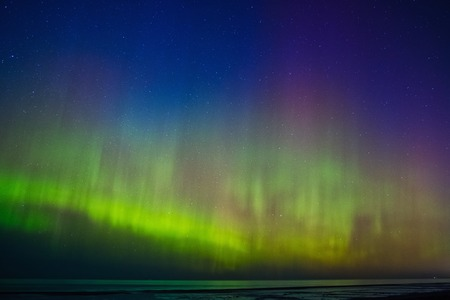 auroral: Beautiful Aurora Borealis over sea