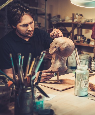 film shooting: Man working in a prosthetic special fx workshop