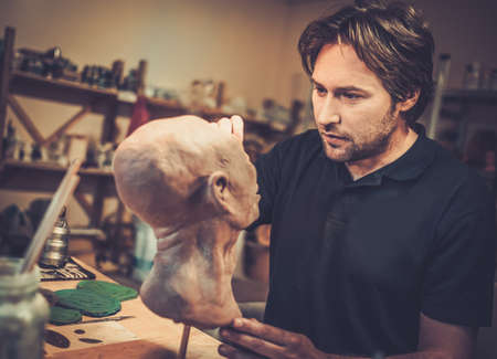 fx: Man working in a prosthetic special fx workshop