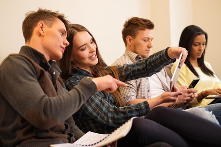 final examination: Group of students preparing for exams in apartment interior Stock Photo